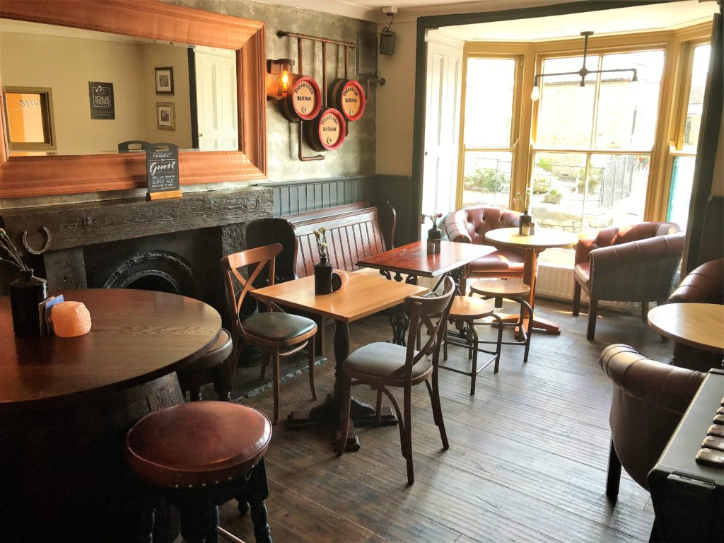 interior window and tables at the Bay Horse pub in Masham