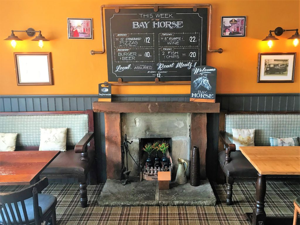 fireplace and chalkboards at the Bay Horse pub in Masham