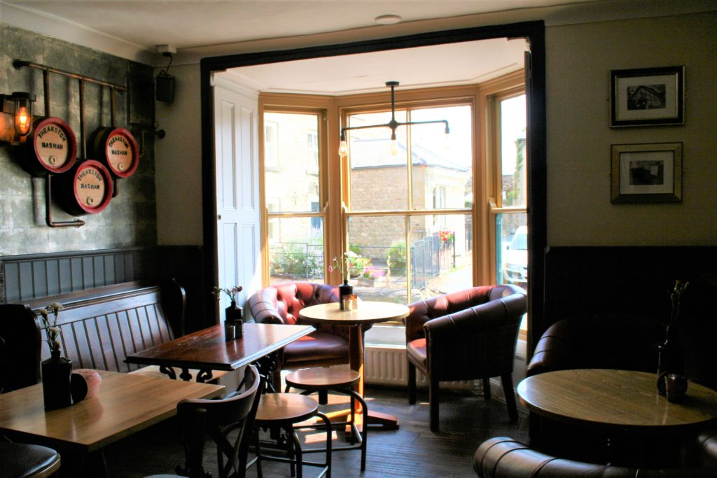 window seat and tables at the Bay Horse pub in Masham