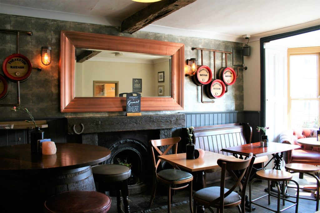 fireplace tables and mirror at the Bay Horse pub in Masham