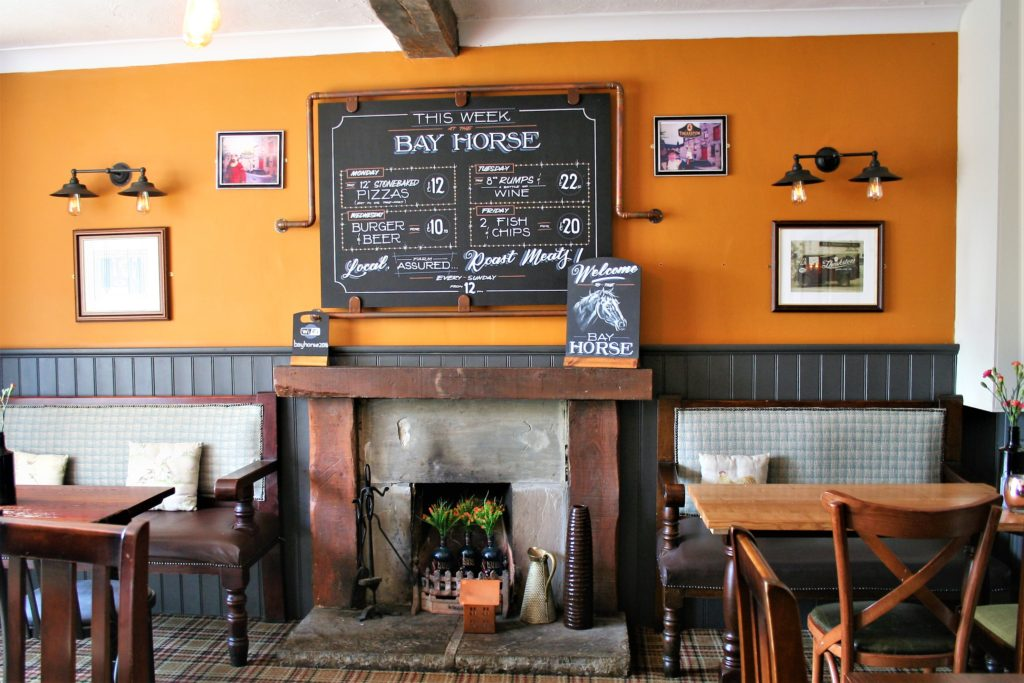 fireplace dining tables and chalkboards at the Bay Horse pub in Masham